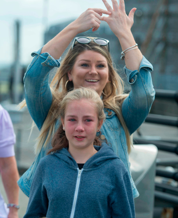 Jade (12) with her mother Jessie saying goodbye to her father Brian Forde Photo: Michael Mac Sweeney/Provision