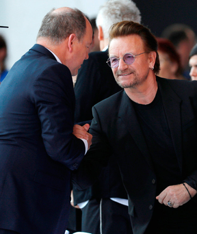Prince Albert II of Monaco greets U2's Bono as he arrives to attend the commemorative ceremony for last year's July 14 Bastille Day fatal truck attack Photo: REUTERS/Eric Gaillard