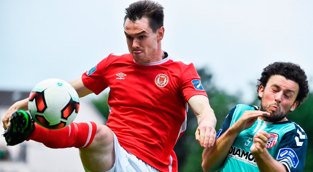 Michael Barker of St Patrick's Athletic in action against Barry McNamee of Derry City. Photo by David Maher/Sportsfile