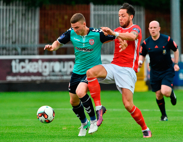 Harry Monaghan of Derry City in action against Billy Dennehy of St Patrick's Athletic. Photo by David Maher/Sportsfile