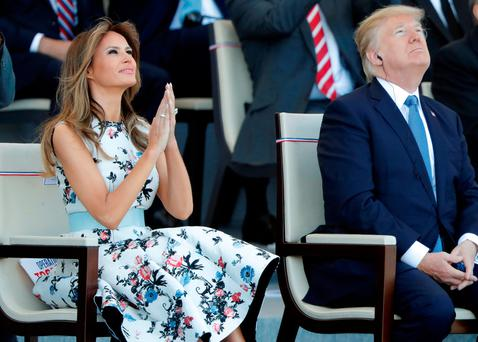 US President Donald Trump and wife Melania attend the Bastille Day military parade on the Champs-Elysees in Paris. Photo: Reuters