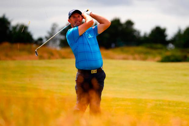 Ireland's Pádraig Harrington hits his second shot on the 9th hole during day two of the Scottish Open at Dundonald in Troon. Photo by Gregory Shamus/Getty Images