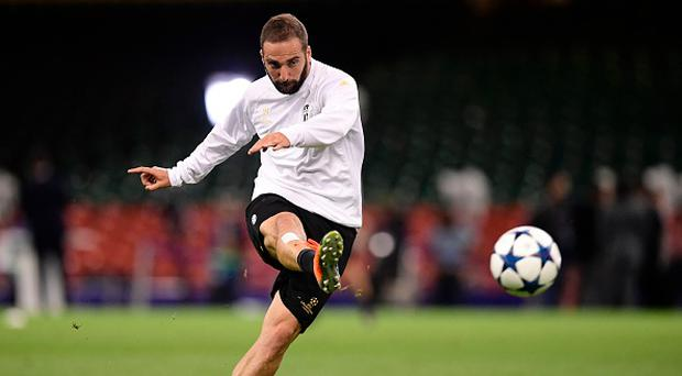 Juventus' Argentinian striker Gonzalo Higuain attends a training session at The Principality Stadium in Cardiff, on June 2, 2017, on the eve of the UEFA Champions League final football match between Juventus and Real Madrid. / AFP PHOTO / JAVIER SORIANO (Photo credit should read JAVIER SORIANO/AFP/Getty Images)