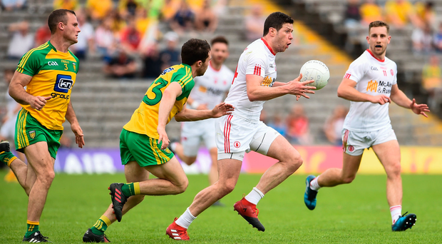 18 June 2017; Sean Cavanagh of Tyrone in action against Cian Mulligan of Donegal during the Ulster GAA Football Senior Championship Semi-Final match between Tyrone and Donegal at St Tiernach's Park in Clones, Co. Monaghan. Photo by Oliver McVeigh/Sportsfile