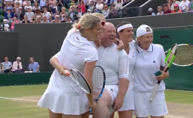 Again he lost the point and, after hugging the players and having his picture taken with them, left the court and returned to his seat Credit: BBC