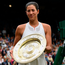 Garbine Muguruza with the trophy after beating Venus Williams in the Ladie's Singles at Wimbledon. Photo: David Ramos/PA