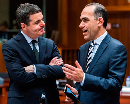 Money talks: Finance Minister Paschal Donohoe (left) chats with Cyprus's Finance Minister Harris Georgiades at a meeting of EU finance ministers in Brussels Photo: AP Photo/Geert Vanden Wijngaert