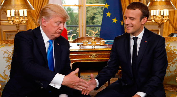 Shake it, baby: French President Emmanuel Macron and US President Donald Trump shake hands as they meet at the Elysee Palace in Paris last Thursday Photo: Kevin Lamarque