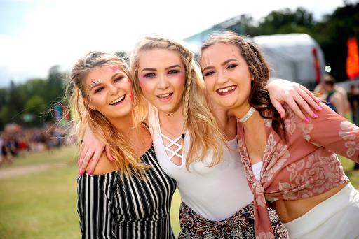 Music to the ears: Aine Graham, Grace Nolan and Alex Szproch pose for the camera at this weekend's Longitude music festival at Marlay Park. The festival will wrap up today, with folk rock band Mumford & Sons closing the main stage Photo: Gerry Mooney