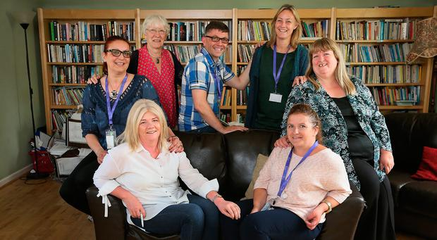 An Cosan, Jobstown educators, [back row] Edina Milivojevic, Liz Waters, Wayne Martin[ Education access officer] Maura McMahon [CEO] and Anne Genockey and sitting Lorraine Quinn and Jennifer Wickham - pictured at An Cosan in Jobstown Tallaght. Photo: Frank Mc Grath