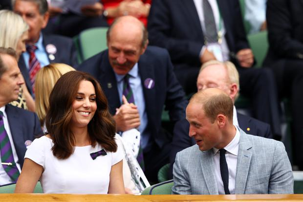Prince William, Duke of Cambridge and Catherine, Duchess of Cambridge look on from the centre court royal box