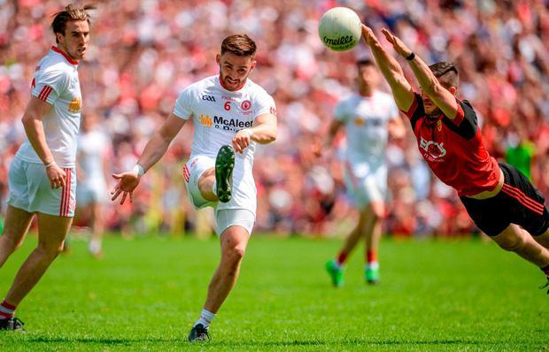 Padraig Hampsey of Tyrone beats the attempted block of Niall McParland of Down during the Ulster GAA Football Senior Championship Final match between Tyrone and Down at St Tiernach's Park in Clones, Co. Monaghan. Photo by Oliver McVeigh/Sportsfile