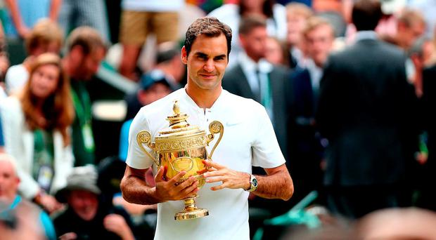 Roger Federer celebrates a record eighth Wimbledon men's singles title by beating Croatian Marin Cilic 6-3 6-1 6-4 in the final on day thirteen of the Wimbledon Championships at The All England Lawn Tennis and Croquet Club, Wimbledon.