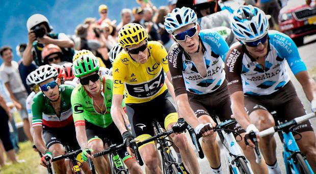 Italy's Fabio Aru, Colombia's Rigoberto Uran, Great Britain's Christopher Froome wearing the overall leader's yellow jersey, France's Romain Bardet and France's Alexis Vuillermoz ride in a breakaway during the 189,5 km fifteenth stage of the 104th edition of the Tour de France cycling race on July 16, 2017 between Laissac-Severac l'Eglise and Le Puy-en-Velay. / AFP PHOTO / Jeff PACHOUDJEFF PACHOUD/AFP/Getty Images