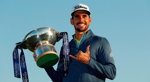 Spain's Rafa Cabrera Bello celebrates with the trophy after winning the Scottish Open. Action Images via Reuters/Lee Smith