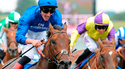 Adam Kirby celebrates after partnering Harry Angel to victory in Saturday's Darley July Cup at Newmarket. Photo: PA Wire