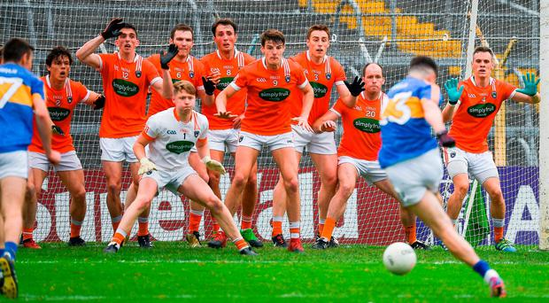 A posse of Armagh players on the line helps goalkeeper Blaine Hughes keep out an injury-time, 13-metre free from Tipperary's Michael Quinlivan. Photo: RAY McMANUS/SPORTSFILE