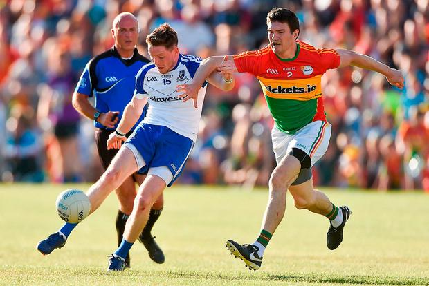 Conor McManus gets a shot away despite the efforts of Carlow's Conor Lawlor. Photo: David Maher/Sportsfile