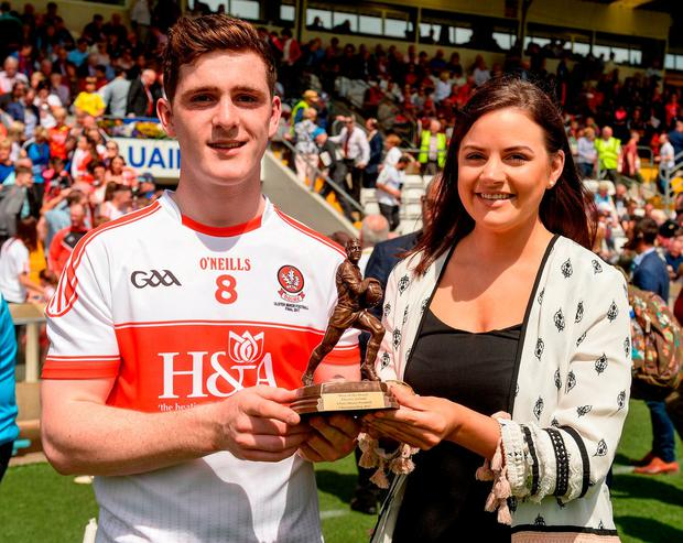 Padraig McGrogan is presented with his Man of The Match award from Lisa McEneaney of Electric Ireland. Photo: Oliver McVeigh/Sportsfile