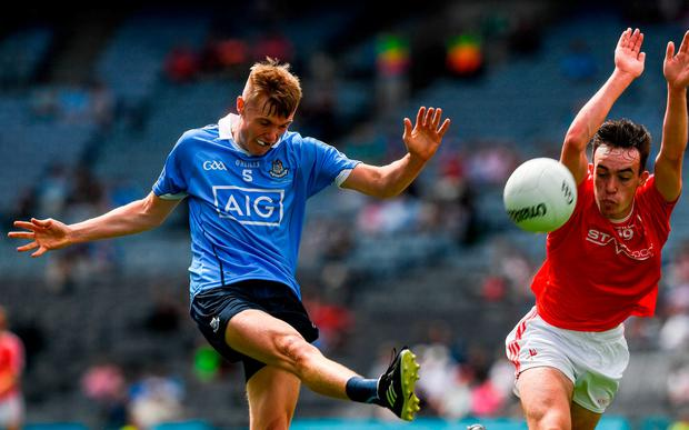 Kieran Kennedy fires a shot ahead of a block from Louth's Ben Mooney. Photo: Ray McManus/Sportsfile