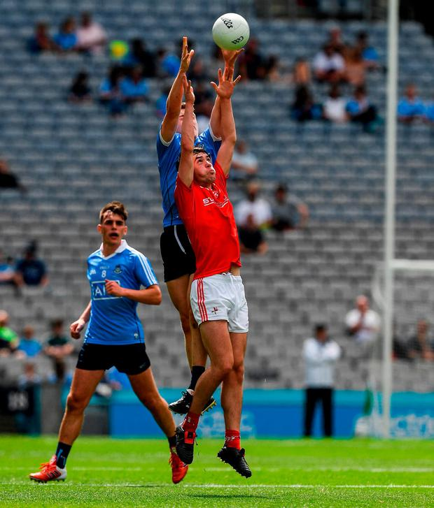 Dublin's Kieran Kennedy and Louth's Ben Mooney battle for possession. Photo: Ray McManus/Sportsfile