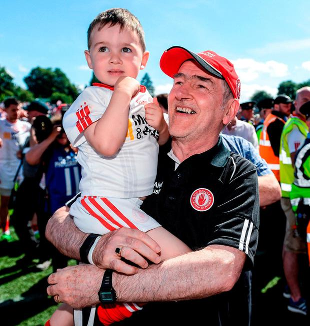 Mickey Harte with grand son Michael junior. Photo: Oliver McVeigh/Sportsfile