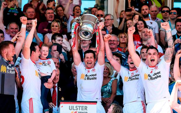 Sean Cavanagh holds aloft the Anglo-Celt Cup for Tyrone after their Ulster GAA Football Senior Championship triumph over Down in Clones. Photo: Oliver McVeigh/Sportsfile