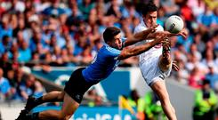 Kildare's Emmet Bolton has his kick blocked by Dublin's David Byrne during yesterday's Leinster SFC final. Photo: SEB DALY/SPORTSFILE