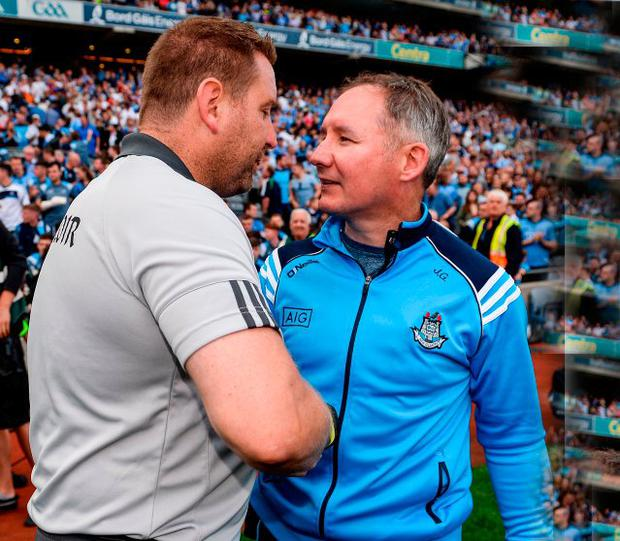 Rival managers Cian O'Neill and Jim Gavin shake hands after yesterday's Croke Park clash. Photo by Seb Daly/Sportsfile