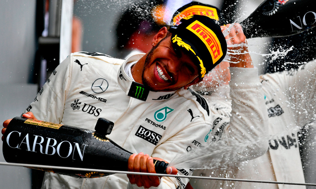 Race winner Lewis Hamilton of Great Britain and Mercedes GP celebrates on the podium during the Formula One Grand Prix at Silverstone. Photo: Getty Images