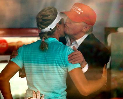 President Donald Trump kisses Norwegian golfer Suzann Pettersen at the US Women's Open tournament at Trump National Golf Club in Bedminster, New Jersey. Photo: Reuters