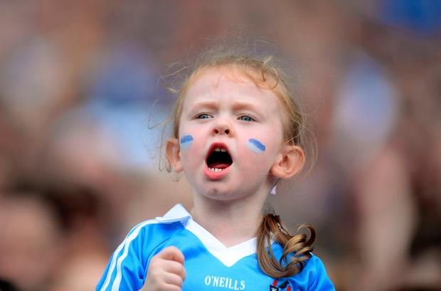 A young Dublin fan shouts for the team Picture: Caroline Quinn