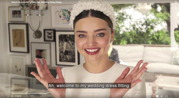 Screen shot of Miranda Kerr's Dior wedding dress fitting video for Vogue