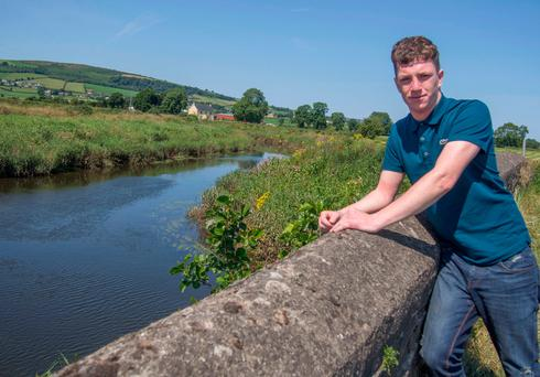Rescue hero Andrew Johnston pictured when he returned to the scene where he rescued a woman trapped in a submerged car. (North West Newspix)