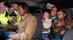 Gardaí simulate a drink driving breath test with actors portraying the suspect and his family in Kildare Street, Dublin. Photo credit: Julien Behal/PA