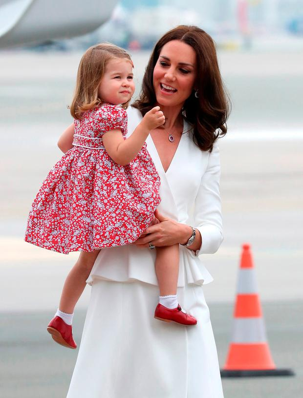 Catherine, Duchess of Cambridge carries Princess Charlotte of Cambridge as they arrive with Prince William, Duke of Cambridge and Prince George of Cambridge on day 1 of their offical visit to Poland on July 17, 2017 in Warsaw, Poland. (Photo by Chris Jackson/Getty Images)