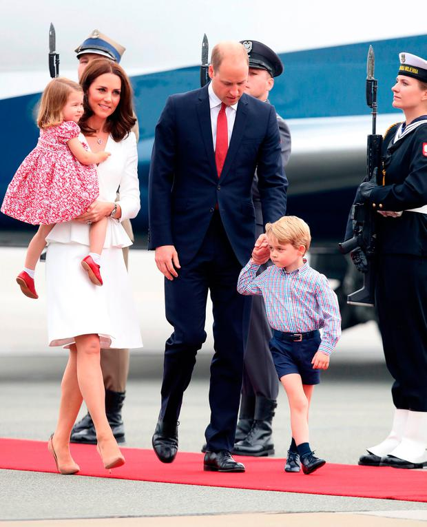 Catherine, Duchess of Cambridge and Prince William, Duke of Cambridge with their children Princess Charlotte of Cambridge and Prince George of Cambridge as they arrive on day 1 of their offical visit to Poland on July 17, 2017 in Warsaw, Poland. (Photo by Chris Jackson/Getty Images)