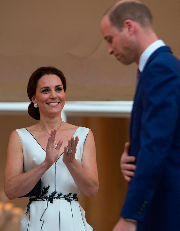Catherine, Duchess of Cambridge applauds after Prince William, Duke of Cambridge delivered a speech during the Queen's Birthday Garden Party at the Orangery on day 1 of their official visit to Poland on July 17, 2017 in Warsaw, Poland. (Photo by Julian Simmonds-Pool/Getty Images)