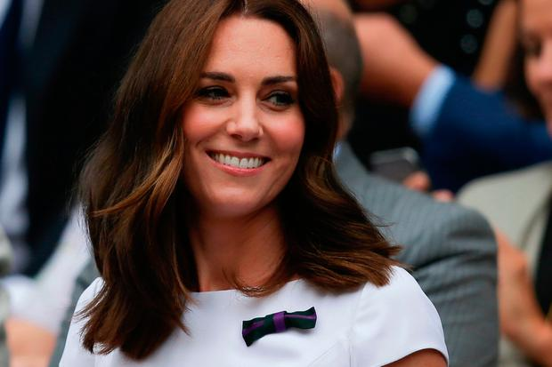 Britain's Catherine, Duchess of Cambridge, sitsin the Royal box on Centre Court for the men's singles final match on the last day of the 2017 Wimbledon Championships at The All England Lawn Tennis Club in Wimbledon, southwest London, on July 16, 2017. / AFP PHOTO / Daniel LEAL-OLIVAS /