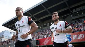 Malgene Ilaua #06 (L) and Derek Carpenter #13 of the Sunwolves enter the pitch prior to the Super Rugby Rd 14 match between Sunwolves and Cheetahs at Prince Chichibu Memorial Ground on May 27, 2017 in Tokyo, Japan. (Photo by Kiyoshi Ota/Getty Images for SUNWOLVES)