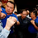 Ruling Democratic Progressive Party (DPP) legislator Chao Tien-lin (L) scuffles with opposition Kuomintang (KMT) legislators during budget meeting for the infrastructure development program, at the Legislative Yuan in Taipei, Taiwan July 18, 2017. REUTERS/Tyrone Siu