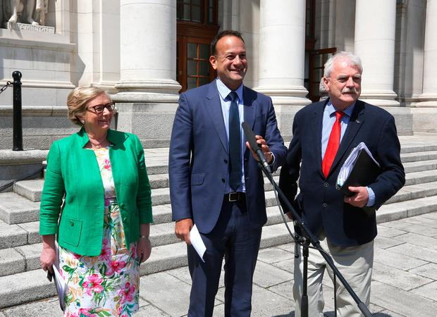 Taoiseach Leo Varadkar with Tanaiste Frances Fitzgerald and Finian McGrath at the announcement regarding the minimum wage at government buildings. Photo: Damien Eagers