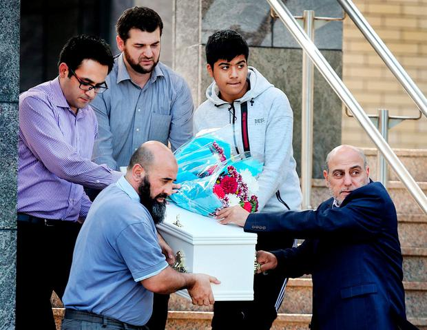An emotional Khalid Omran (far right), the father of three-year-old Omar Omran who died in a stabbing tragedy in Dublin last week, helps carry his son's remains outside the mosque in Clonskeagh. Photo: Steve Humphreys