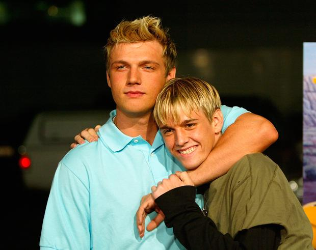 Aaron and Nick Carter (L) aririve for the