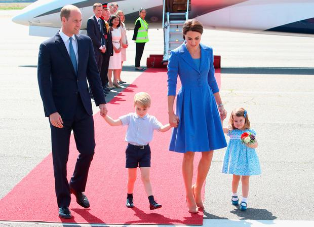 Prince William, Duke of Cambridge, Catherine, Duchess of Cambridge, Prince George of Cambridge and Princess Charlotte of Cambridge arrive at Berlin Tegel Airport during an official visit to Poland and Germany on July 19, 2017 in Berlin, Germany. (Photo by Chris Jackson/Getty Images)