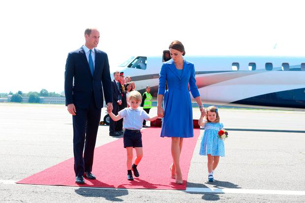 Prince William, Duke of Cambridge, Catherine, Duchess of Cambridge with Prince George of Cambridge and Princess Charlotte of Cambridge as they arrive at Berlin Tegel Airport during an official visit to Poland and Germany on July 19, 2017 in Berlin, Germany. (Photo by Ian Vogler - Pool/Getty Images)