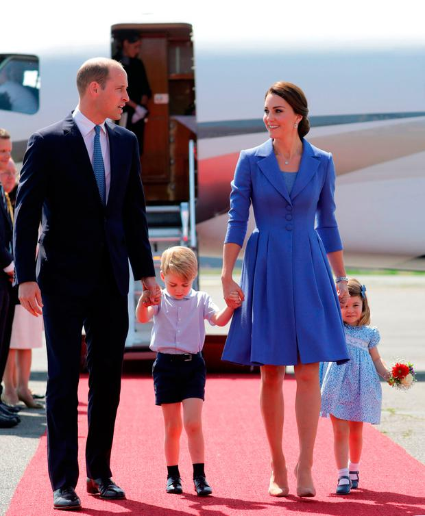 Britain's Prince William, Duke of Cambridge, his wife Kate, the Duchess of Cambridge with their children Prince George and Princess Charlotte arrive at the airport in Berlin on July 19, 2017
