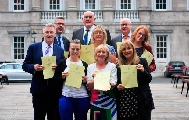 Members of the Seanad Civil Engagement Group (back, from left) Niall O Donnghaile, Billy Lawless and Paul Gavan; (middle) John Dolan, Grace O'Sullivan and Alice Mary Higgins (front) Lynn Ruane, Colette Kelleher and Frances Black at the proposal of a bill to enable refugees in Ireland to be reunited with their dependent loved ones. Photo: Collins