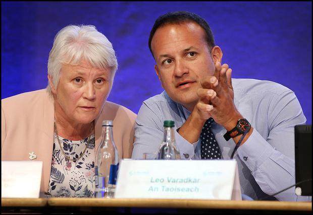 Catherine Byrne, Minister of State for Health, chats with Taoiseach Leo Varadkar at the 'Reducing Harm, Supporting Recovery' Conference at Dublin Castle. Photo: Steve Humphreys