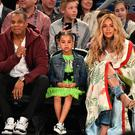(L-R) Jay Z, Blue Ivy Carter and Beyoncé Knowles attend the 66th NBA All-Star Game at Smoothie King Center on February 19, 2017 in New Orleans, Louisiana. (Photo by Theo Wargo/Getty Images)